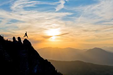 hiker on the peak at sunset