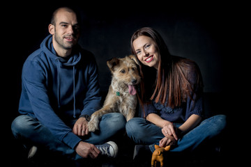portrait of couple and their cute dog