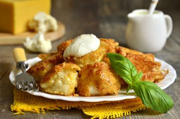 Fried cauliflower in cheese crisp.