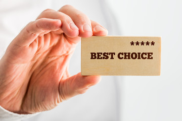 Man holding a wooden rectangle saying Best Choice