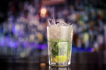Cocktail with lime, rum and mint