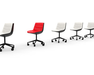 Red office chair in row of white office chairs.