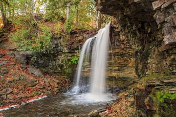 natural view of Niagara escarpment waterfall in autumn  woods