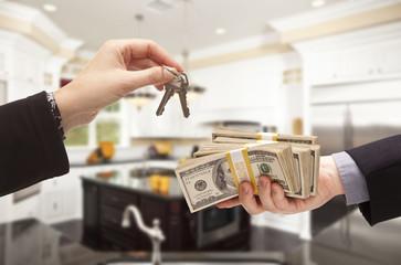 Handing Over Cash for Keys Inside Beautiful Home
