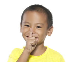 asian elementary school student with his finger over her mouth,