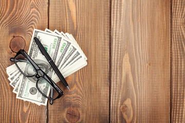 Money cash, glasses and pen