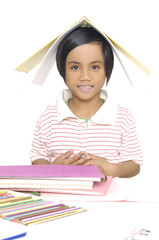 little girl smile student read the book with book on head