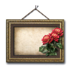 Vintage picture frame and a bouquet of red roses
