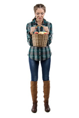 Photo of woman looking at basket with apples