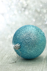Christmas blue ball in a brightly background