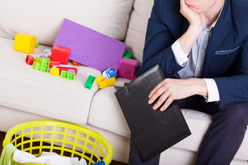 Man in suit sitting on sofa