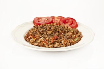 Turkish Kokorec - lamb intestine food portion white background