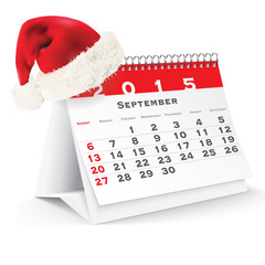 September 2015 desk calendar with Christmas hat
