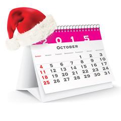 October 2015 desk calendar with Christmas hat