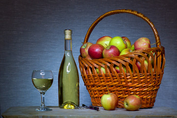 white wine and the basket of apple on the table