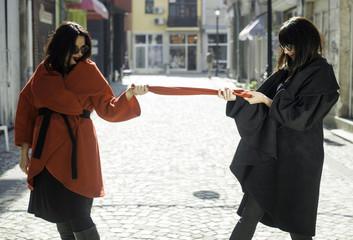 Two women in jackets on a street