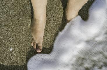 Two legs in sea waves
