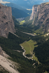 aerial view of U-shaped glacial valley in Dolomites