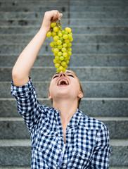 Young woman eating  grapes