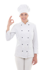young woman chef  showing ok sign isolated on white