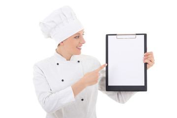 young woman in chef uniform showing clipboard with blank paper i
