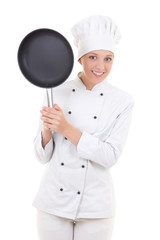 happy young woman in chef uniform with frying pan isolated on wh