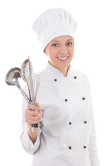 young woman in chef uniform with kitchen equipment isolated on w