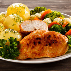 Fried chicken fillets and vegetables