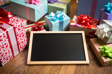 Beautifully wrapped gifts with blackboard