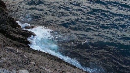 Ocean waves crashing the rock