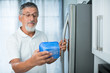 Is this still fine? Senior man in his kitchen by the fridge