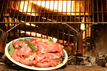 fireplace home with the pork to be grilled over glowing embers