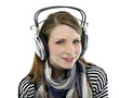 Beautiful young smiling woman listens to music