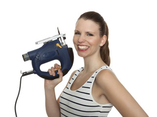 Young craftswoman with a jigsaw in front of white background