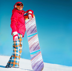 Girl with snowboard on the snow