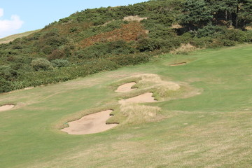 A Collection of Sand Bunkers on a Links Golf Course.