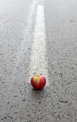 Middle of the road with apple