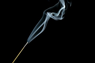 Incense stick with smoke isolated on black background