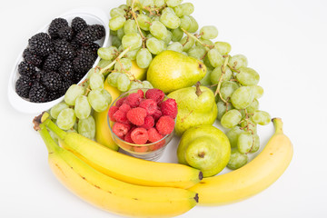 Raspberries Blackberries Grapes Bananas and Pears on White