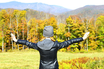 Young woman in autumn landscape, Vermont