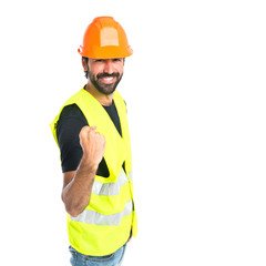 Lucky workman over isolated white background