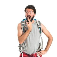 Backpacker making suicide gesture over white background