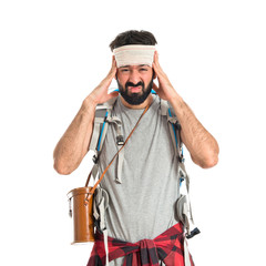 Adventurer with head injury over white background