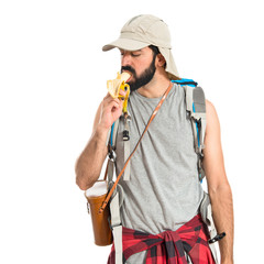 Man eating a banana over white background