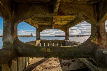 Blyth Harbour viewed through pier foundations