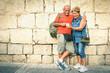 Leinwanddruck Bild - Happy senior couple having fun with a modern smartphone