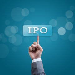 IPO. hand man pressing ipo button.