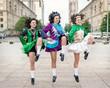 Three women in irish dance dresses dancing