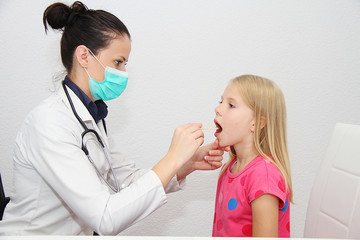 Young female child examined by woman doctor