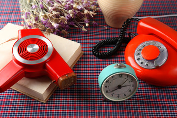 Retro things on table-hairdryer, clock, phone, book